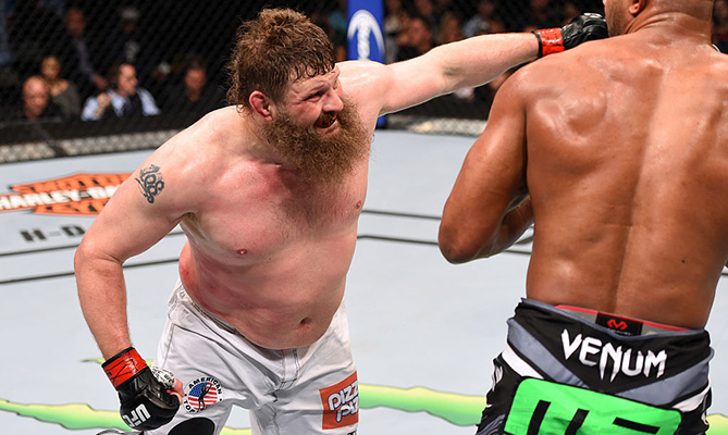 DALLAS, TX - MARCH 14:  (L-R) Roy Nelson punches Alistair Overeem in their heavyweight bout during the UFC 185 event at the American Airlines Center. (Photo by Josh Hedges/Zuffa LLC)