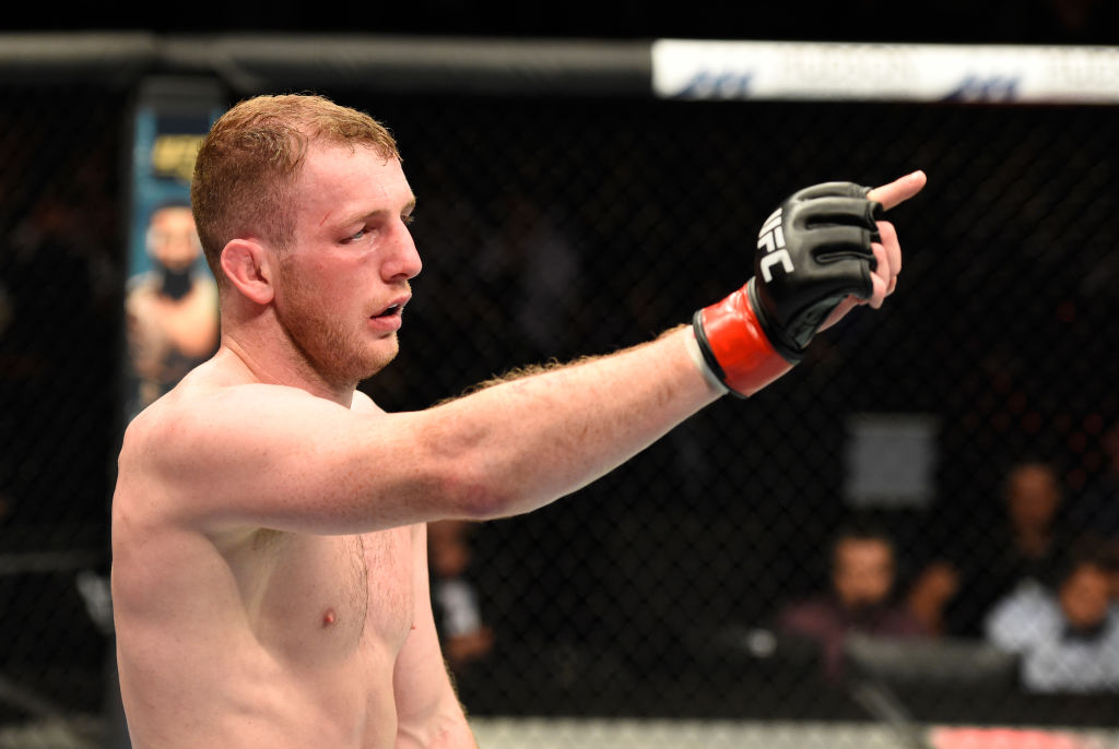 <a href='../fighter/Danny-Henry'>Danny Henry</a> raises his hand after facing <a href='../fighter/Daniel-Teymur'>Daniel Teymur</a> during the <a href='../event/UFC-Silva-vs-Irvin'>UFC Fight Night </a>on July 16, 2017 in Glasgow, Scotland. (Photo by Josh Hedges/Zuffa LLC)