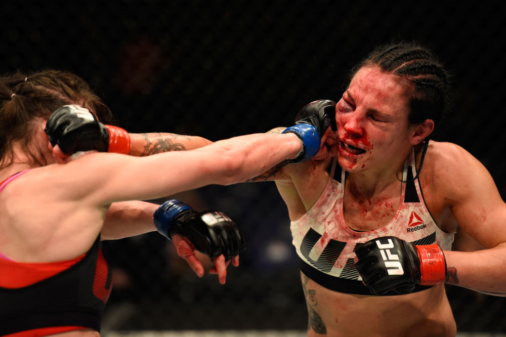 LONDON, ENGLAND - MARCH 18:  (L-R) Lucie Pudilova of the Czech Republic punches Lina Lansberg of Sweden in their women's bantamweight fight during the UFC Fight Night event at The O2 arena on March 18, 2017 in London, England. (Photo by Josh Hedges/Zuffa LLC)