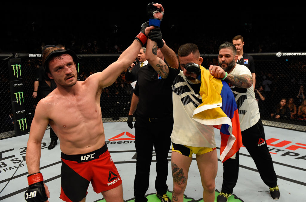 LONDON, ENGLAND - MARCH 18: (L-R) Brad Pickett of England raises Marlon Vera of Ecuador's hand after their bantamweight fight during the UFC Fight Night event at The O2 arena on March 18, 2017 in London, England. (Photo by Josh Hedges/Zuffa LLC)