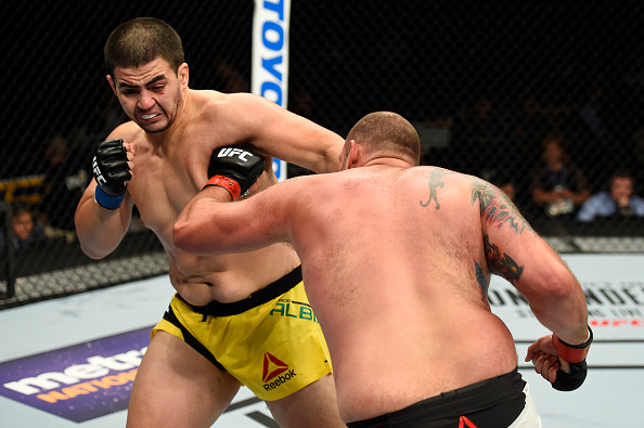 UNIONDALE, NY - JULY 22:  (L-R) Junior Albini punches Timothy Johnson in their heavyweight bout during the UFC Fight Night event inside the Nassau Veterans Memorial Coliseum on July 22, 2017 in Uniondale, New York. (Photo by Josh Hedges/Zuffa LLC/Zuffa LLC via Getty Images)