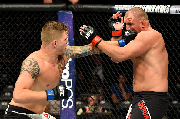 UNIONDALE, NY - JULY 22:  (L-R) Chase Sherman punches Damian Grabowski of Poland in their heavyweight bout during the UFC Fight Night event inside the Nassau Veterans Memorial Coliseum on July 22, 2017 in Uniondale, New York. (Photo by Josh Hedges/Zuffa LLC/Zuffa LLC via Getty Images)