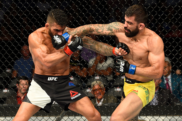UNIONDALE, NY - JULY 22:  (R-L) Elizeu Zaleski dos Santos of Brazil punches Lyman Good in their welterweight bout during the UFC Fight Night event inside the Nassau Veterans Memorial Coliseum on July 22, 2017 in Uniondale, New York. (Photo by Josh Hedges/Zuffa LLC/Zuffa LLC via Getty Images)