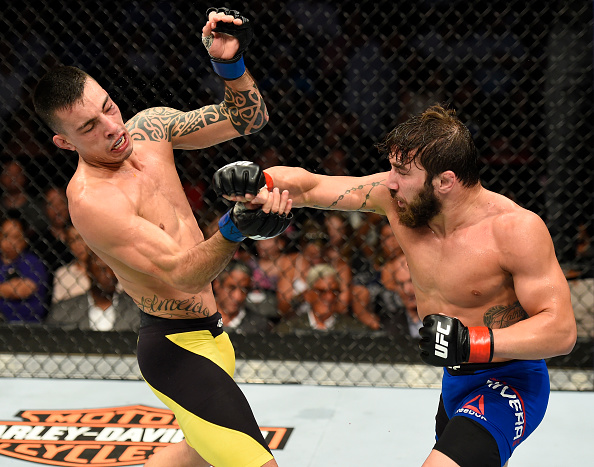 UNIONDALE, NY - JULY 22:  (R-L) Jimmie Rivera punches Thomas Almeida of Brazil in their bantamweight bout during the UFC Fight Night event inside the Nassau Veterans Memorial Coliseum on July 22, 2017 in Uniondale, New York. (Photo by Josh Hedges/Zuffa LLC/Zuffa LLC via Getty Images)