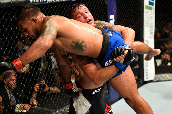 UNIONDALE, NY - JULY 22:  (R-L) Darren Elkins attempts to take down Dennis Bermudez in their featherweight bout during the UFC Fight Night event inside the Nassau Veterans Memorial Coliseum on July 22, 2017 in Uniondale, New York. (Photo by Josh Hedges/Zuffa LLC/Zuffa LLC via Getty Images)