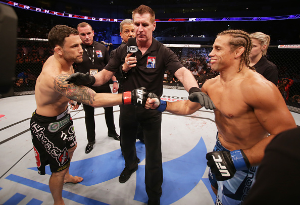 MANILA, PHILIPPINES - MAY 16: (L to R) Frankie Edgar of the United States and Uriah Faber of the United States touch gloves before  their featherweight fight during the UFC Fight Night event at the Mall of Asia Arena on May 16, 2015 in Manila, Philippines. (Photo by Mitch Viquez/Zuffa LLC/Zuffa LLC via Getty Images)