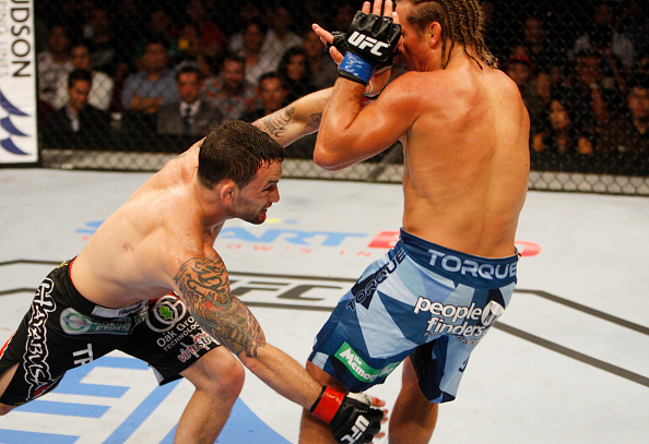 MANILA, PHILIPPINES - MAY 16:  Frankie Edgar of the United States takes down Uriah Faber of the United States in their featherweight fight during the UFC Fight Night event at the Mall of Asia Arena on May 16, 2015 in Manila, Philippines. (Photo by Mitch Viquez/Zuffa LLC/Zuffa LLC via Getty Images)