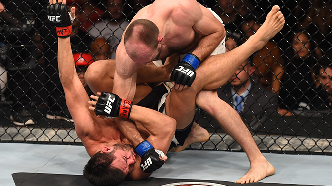 (R-L) <a href='../fighter/bartosz-fabinski'>Bartosz Fabinski</a> of Poland punches <a href='../fighter/hector-urbina'>Hector Urbina</a> of Mexico in their welterweight bout during the UFC Fight Night event at Arena Monterrey on November 21, 2015 in Monterrey, Mexico. (Photo by Jeff Bottari/Zuffa LLC)