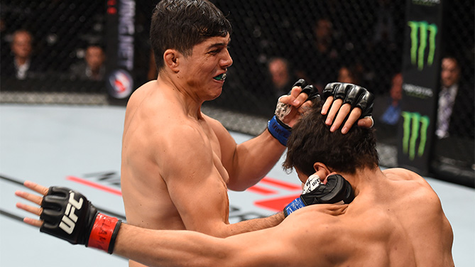 (L-R) Alvaro Herrera of Mexico knocks out Vernon Ramos of Panama in their welterweight bout during the UFC Fight Night event at Arena Monterrey on November 21, 2015 in Monterrey, Mexico. (Photo by Jeff Bottari/Zuffa LLC)