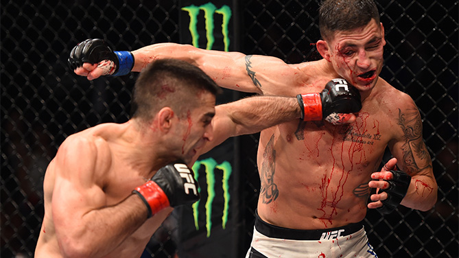 (L-R) Ricardo Lamas of the United States punches Diego Sanchez of the United States in their featherweight bout during the UFC Fight Night event at Arena Monterrey on November 21, 2015 in Monterrey, Mexico. (Photo by Jeff Bottari/Zuffa LLC)