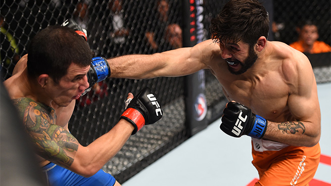 (R-L) Polo Reyes of Mexico punches Cesar Arzamendia of Paraguay in their lightweight bout during the UFC Fight Night event at Arena Monterrey on November 21, 2015 in Monterrey, Mexico. (Photo by Jeff Bottari/Zuffa LLC)