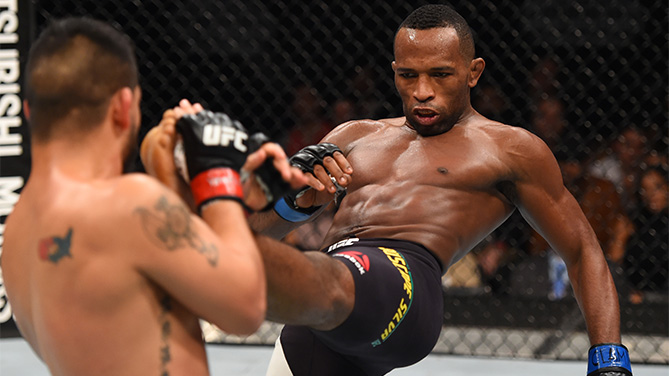 (R-L) Leandro Silva of Brazil kicks Efrain Escudero of Mexico in their lightweight bout during the UFC Fight Night event at Arena Monterrey on November 21, 2015 in Monterrey, Mexico. (Photo by Jeff Bottari/Zuffa LLC)