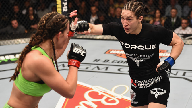 Sara McMann punches <a href='../fighter/Miesha-Tate'>Miesha Tate</a> in their women's bantamweight bout during the UFC 183 event at the MGM Grand Garden Arena on January 31, 2015 in Las Vegas, Nevada. (Photo by Josh Hedges/Zuffa LLC/Zuffa LLC via Getty Images)