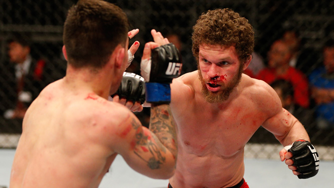 Dustin Ortiz punches Ray Borg in their flyweight bout during the FOX UFC Saturday event at the Amway Center on April 19, 2014 in Orlando, Florida. (Photo by Josh Hedges/Zuffa LLC/Zuffa LLC via Getty Images)