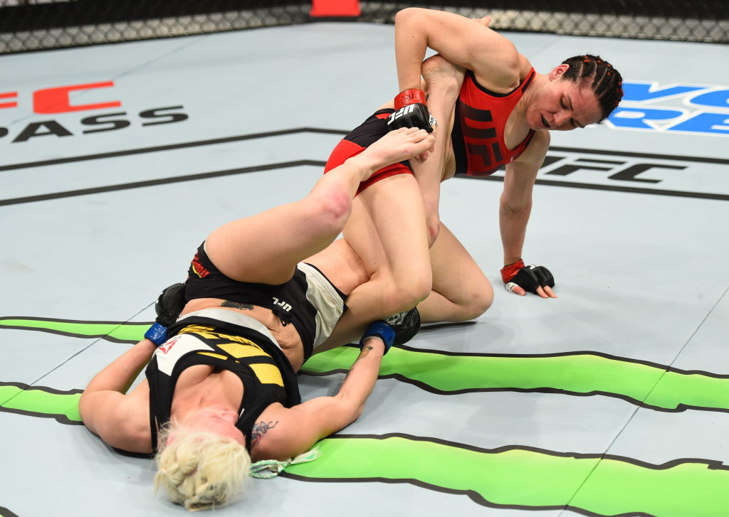 NASHVILLE, TN - APRIL 22:  (R-L) Alexis Davis of the Canada attempts to secure a leg lock against Cindy Dandois of Belgium in their women's bantamweight bout during the UFC Fight Night event at Bridgestone Arena on April 22, 2017 in Nashville, Tennessee. (Photo by Jeff Bottari/Zuffa LLC)