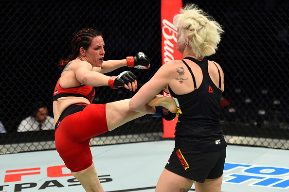 Alexis Davis kicks Cindy Dandois during their bantamweight bout at Fight Night Nashville