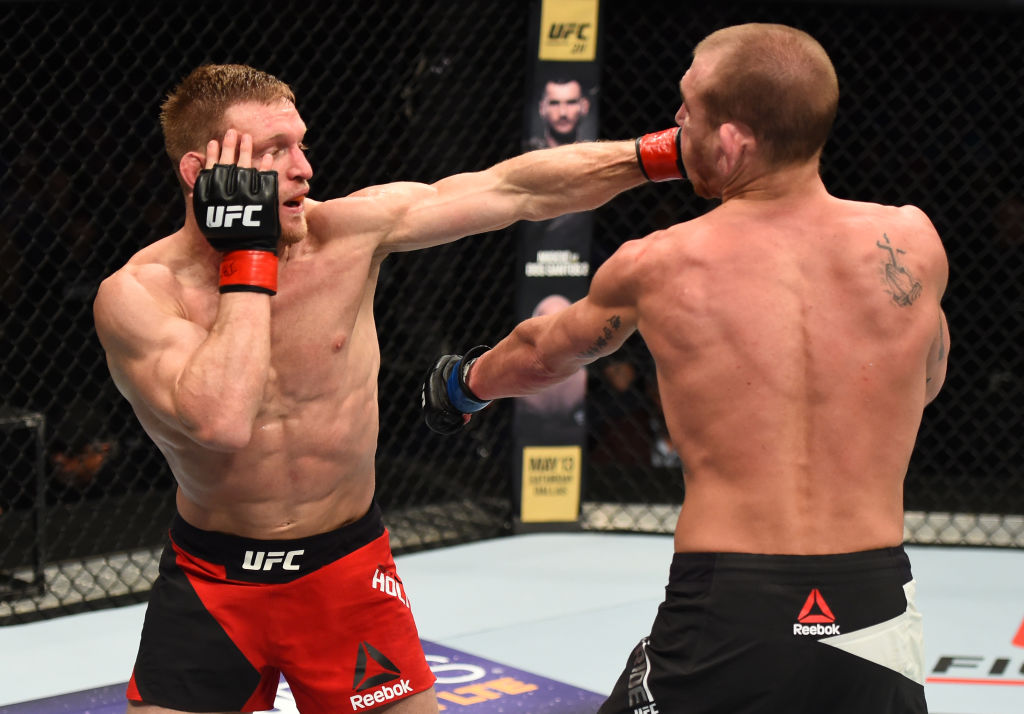 NASHVILLE, TN - APRIL 22:  (L-R) Scott Holtzman punches Michael McBride in their lightweight bout during the UFC Fight Night event at Bridgestone Arena on April 22, 2017 in Nashville, Tennessee. (Photo by Jeff Bottari/Zuffa LLC)