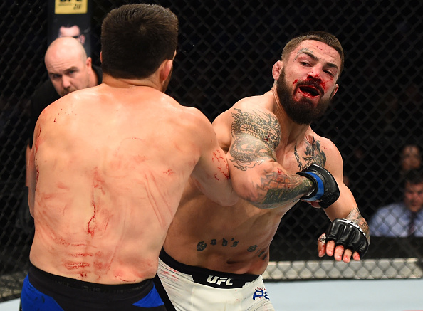 Mike Perry elbows Jake Ellenberger during their bout at Fight Night Nashville in April