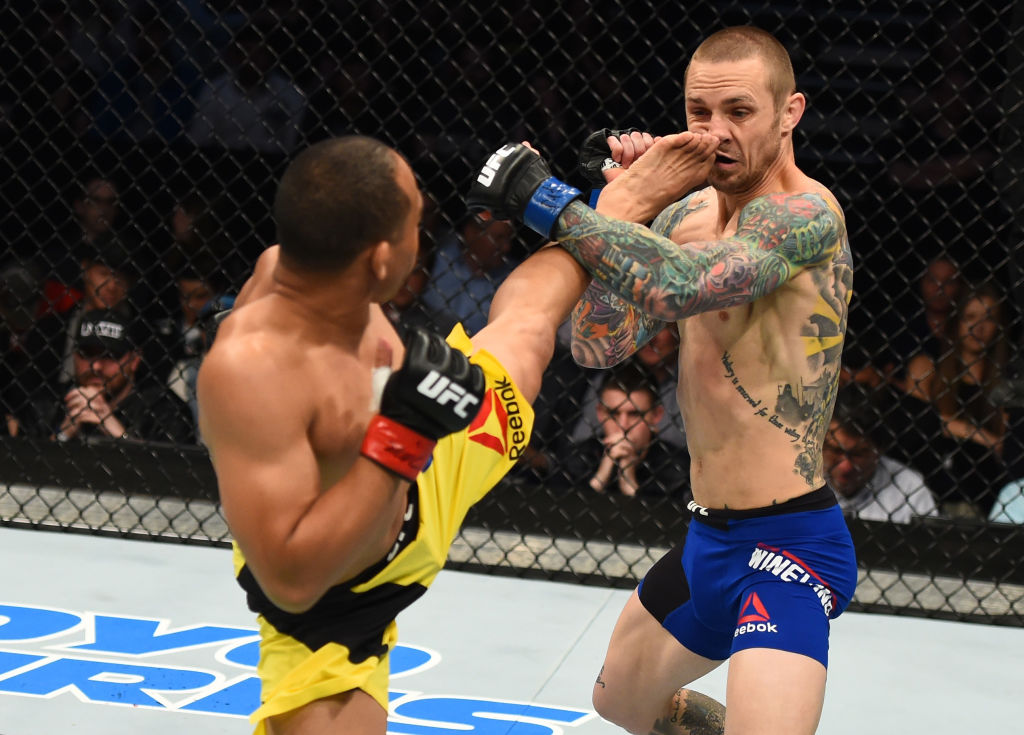 NASHVILLE, TN - APRIL 22:  (L-R) John Dodson kicks Eddie Wineland in their bantamweight bout during the UFC Fight Night event at Bridgestone Arena on April 22, 2017 in Nashville, Tennessee. (Photo by Jeff Bottari/Zuffa LLC)