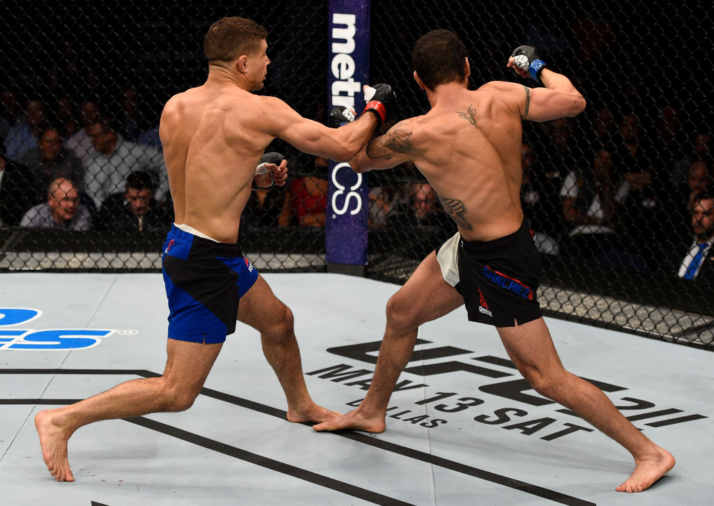 NASHVILLE, TN - APRIL 22:  (L-R) Al Iaquinta knocks down Diego Sanchez with a right in their lightweight bout during the UFC Fight Night event at Bridgestone Arena on April 22, 2017 in Nashville, Tennessee. (Photo by Jeff Bottari/Zuffa LLC)
