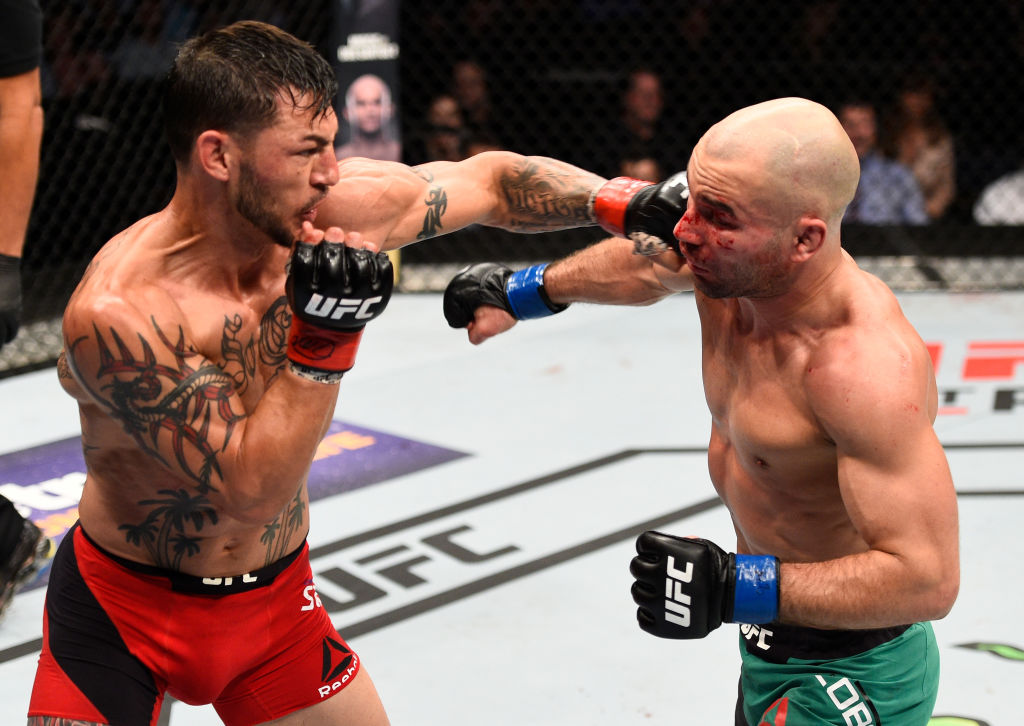 NASHVILLE, TN - APRIL 22: (L-R) Cub Swanson punches Artem Lobov of Russia in their featherweight bout during the UFC Fight Night event at Bridgestone Arena on April 22, 2017 in Nashville, Tennessee. (Photo by Jeff Bottari/Zuffa LLC)