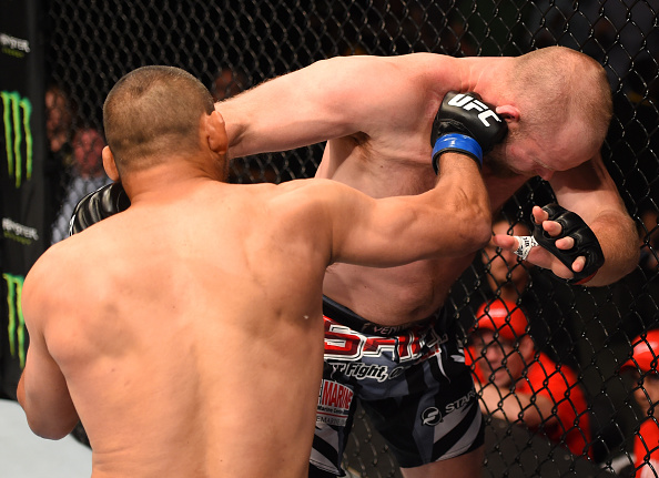 NEW ORLEANS, LA - JUNE 06: (L-R) Dan Henderson punches Tim Boetsch in their middleweight bout during the UFC event at the Smoothie King Center. (Photo by Josh Hedges/Zuffa LLC/Zuffa LLC)