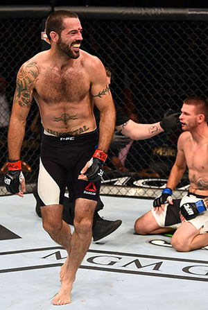 Matt Brown (left) reacts to his victory over <a href='../fighter/Tim-Means'>Tim Means</a> in their welterweight fight during the UFC 189 event inside MGM Grand Garden Arena on July 11, 2015 in Las Vegas, Nevada. (Photo by Josh Hedges/Zuffa LLC)