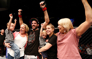 Matt Brown celebrates with his family after his TKO victory over <a href='../fighter/Erick-Silva'>Erick Silva</a> in their welterweight fight during the <a href='../event/UFC-Silva-vs-Irvin'>UFC Fight Night </a>event at the U.S. Bank Arena on May 10, 2014 in Cincinnati, OH. (Photo by Josh Hedges/Zuffa LLC)