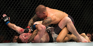 Dustin Poirier (top) punches Joe Duffy of Ireland in their lightweight bout during the UFC 195 event inside MGM Grand Garden Arena on Jan. 2, 2016 in Las Vegas, NV.  (Photo by Brandon Magnus/Zuffa LLC)