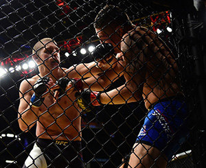 Joe Lauzon punches <a href='../fighter/Diego-Sanchez'>Diego Sanchez</a> in their lightweight bout during the UFC 200 event on July 9, 2016 at T-Mobile Arena in Las Vegas, NV (Photo by Harry How/Zuffa LLC)