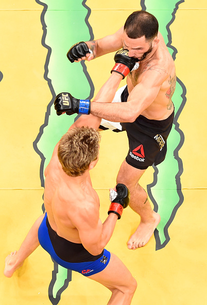 Sage Northcutt punches <a href='../fighter/enrique-marin'>Enrique Marin</a> of Spain in their lightweight bout during the UFC 200 event at T-Mobile Arena on July 9, 2016 in Las Vegas, NV (Photo by Josh Hedges/Zuffa LLC)