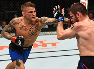 Dustin Poirier punches Jim Miller in their lightweight bout during the UFC 208 event inside Barclays Center on Feb. 11, 2017 in Brooklyn, NY (Photo by Jeff Bottari/Zuffa LLC)
