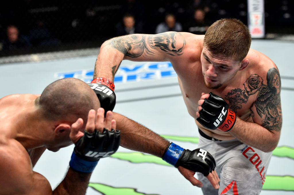 NORFOLK, VA - NOVEMBER 11: (R-L) Jake Collier punches Marcel Fortuna of Brazil in their light heavyweight bout during the UFC Fight Night event inside the Ted Constant Convention Center on November 11, 2017 in Norfolk, Virginia. (Photo by Brandon Magnus/Zuffa LLC)