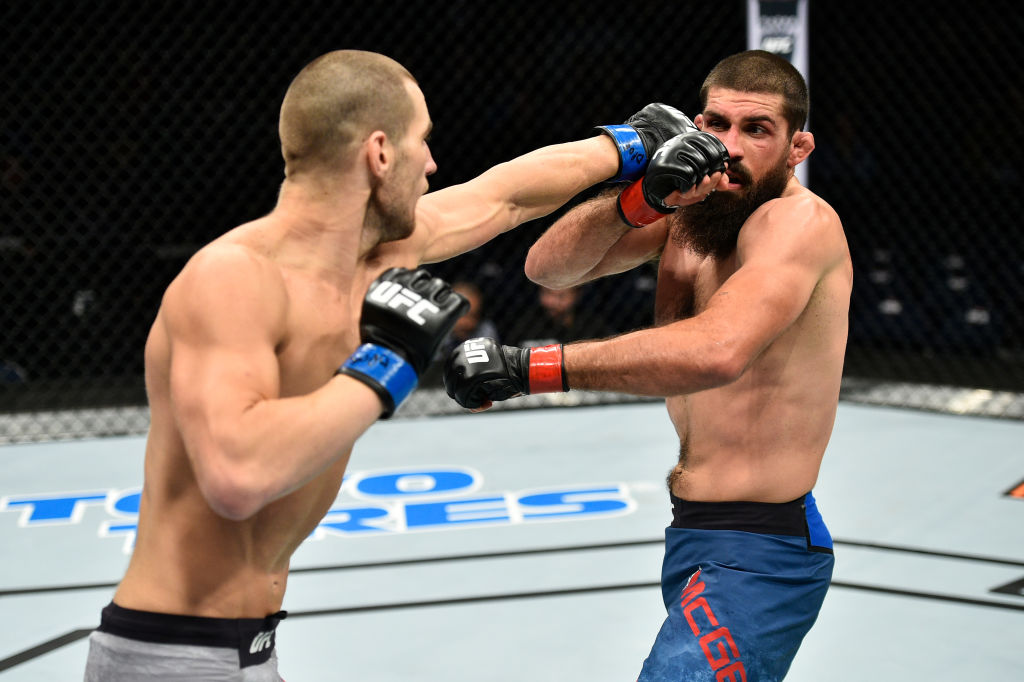 Sean Strickland punches Court McGee in their welterweight bout during the UFC Fight Night event inside the Ted Constant Convention Center on November 11, 2017 in Norfolk, Virginia. (Photo by Brandon Magnus/Zuffa LLC)