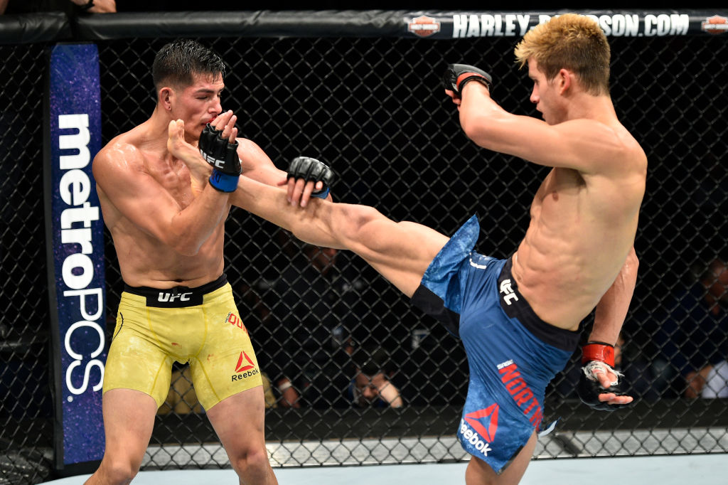 NORFOLK, VA - NOVEMBER 11:  (R-L) Sage Northcutt kicks Michel Quinones in their lightweight bout during the UFC Fight Night event inside the Ted Constant Convention Center on November 11, 2017 in Norfolk, Virginia. (Photo by Brandon Magnus/Zuffa LLC)