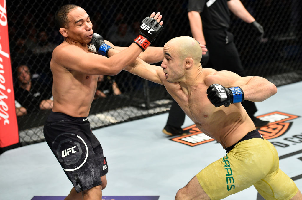Marlon Moraes of Brazil punches John Dodson in their bantamweight bout during the UFC Fight Night event inside the Ted Constant Convention Center on November 11, 2017 in Norfolk, Virginia. (Photo by Brandon Magnus/Zuffa LLC)