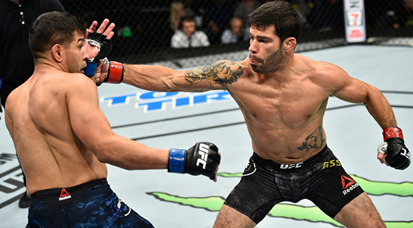 <a href='../fighter/Raphael-Assuncao'>Raphael Assuncao</a> of Brazil punches <a href='../fighter/matthew-lopez'>Matthew Lopez</a> in their bantamweight bout during the UFC Fight Night event inside the Ted Constant Convention Center on November 11, 2017 in Norfolk, Virginia. (Photo by Brandon Magnus/Zuffa LLC)