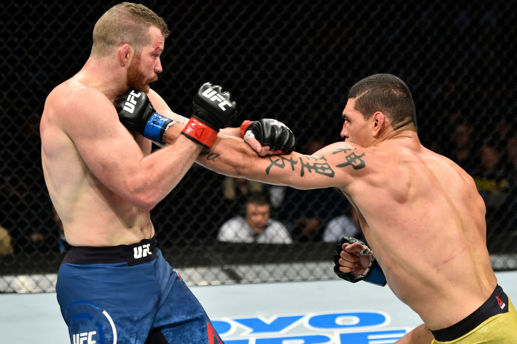 NORFOLK, VA - NOVEMBER 11:  (R-L) Cezar Ferreira of Brazil punches Nate Marquardt in their middleweight bout during the UFC Fight Night event inside the Ted Constant Convention Center on November 11, 2017 in Norfolk, Virginia. (Photo by Brandon Magnus/Zuffa LLC)