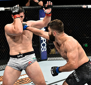 <a href='../fighter/Andrei-Arlovski'>Andrei Arlovski</a> of Belarus punches <a href='../fighter/Junior-Albini'>Junior Albini</a> of Brazil in their heavyweight bout during the UFC Fight Night event inside the Ted Constant Convention Center on November 11, 2017 in Norfolk, Virginia. (Photo by Brandon Magnus/Zuffa LLC)