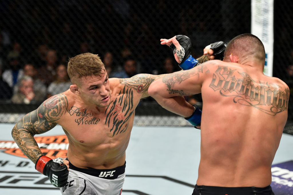 NORFOLK, VA - NOVEMBER 11: (L-R) Dustin Poirier punches Anthony Pettis in their lightweight bout during the UFC Fight Night event inside the Ted Constant Convention Center on November 11, 2017 in Norfolk, Virginia. (Photo by Brandon Magnus/Zuffa LLC)