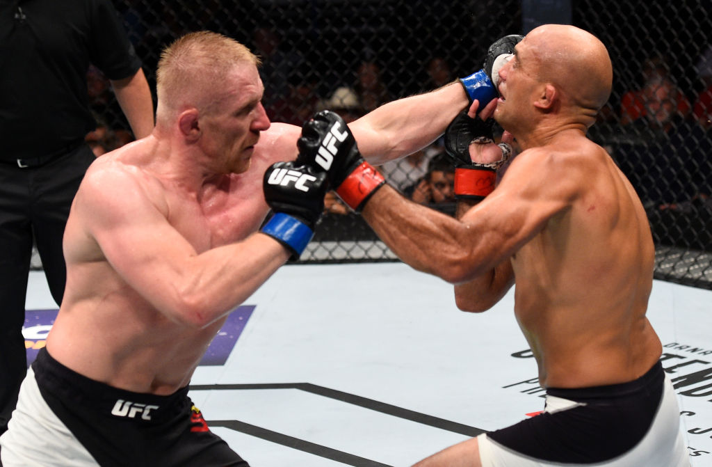 OKLAHOMA CITY, OK - JUNE 25:   (L-R) Dennis Siver of Germany punches BJ Penn in their featherweight bout during the UFC Fight Night event at the Chesapeake Energy Arena on June 25, 2017 in Oklahoma City, Oklahoma. (Photo by Brandon Magnus/Zuffa LLC)