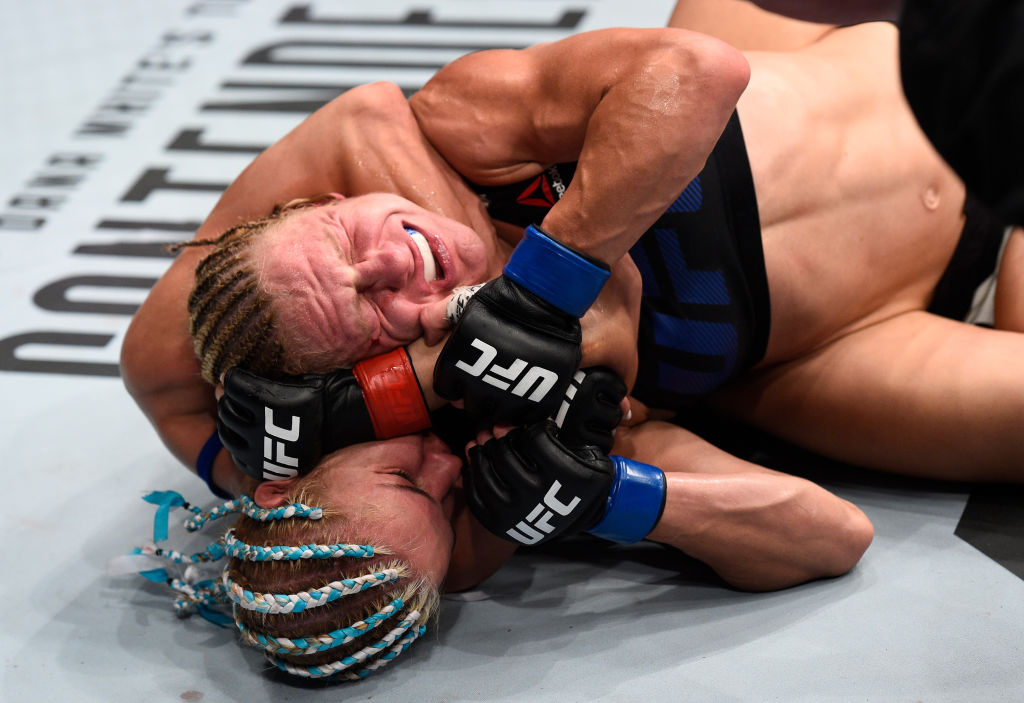 OKLAHOMA CITY, OK - JUNE 25:   (L-R) Felice Herrig attempts to secure a rear choke submission against Justine Kish in their women's strawweight bout during the UFC Fight Night event at the Chesapeake Energy Arena on June 25, 2017 in Oklahoma City, Oklahoma. (Photo by Brandon Magnus/Zuffa LLC)