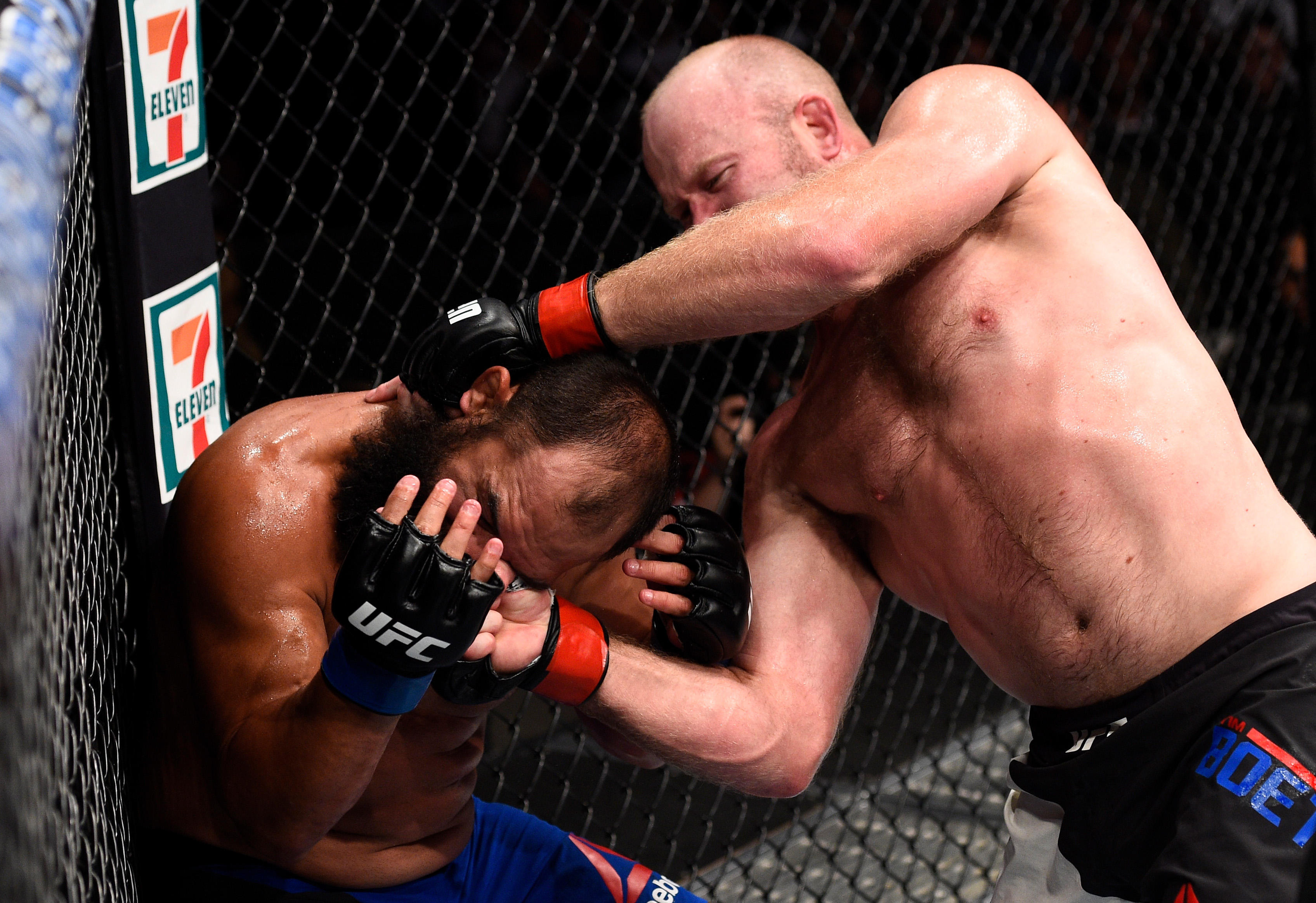 OKLAHOMA CITY, OK - JUNE 25:   (R-L) Tim Boetsch punches Johny Hendricks in their middleweight bout during the UFC Fight Night event at the Chesapeake Energy Arena on June 25, 2017 in Oklahoma City, Oklahoma. (Photo by Brandon Magnus/Zuffa LLC)