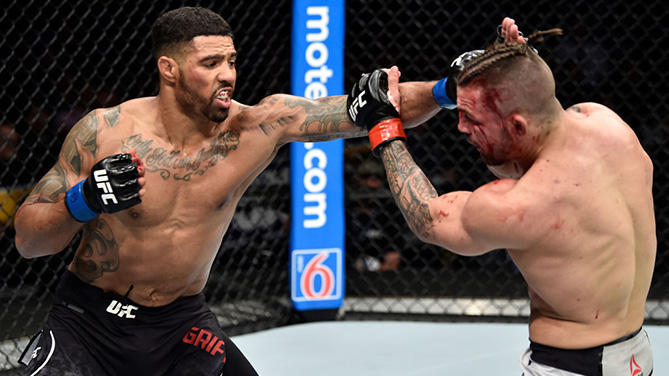 ORLANDO, FL - FEB. 24:  (L-R) Max Griffin punches Mike Perry in their welterweight bout during the UFC Fight Night event at Amway Center on February 24, 2018.  (Photo by Jeff Bottari/Zuffa LLC)