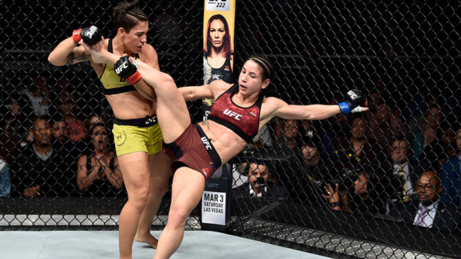ORLANDO, FL - FEB. 24:  (L-R) Jessica Andrade of Brazil takes down Tecia Torres in their women's strawweight bout during the UFC Fight Night event at Amway Center.  (Photo by Jeff Bottari/Zuffa LLC)
