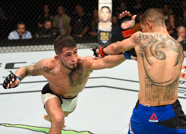 Sergio Pettis punches John Moraga during their bout at Fight Night Phoenix on Sunday