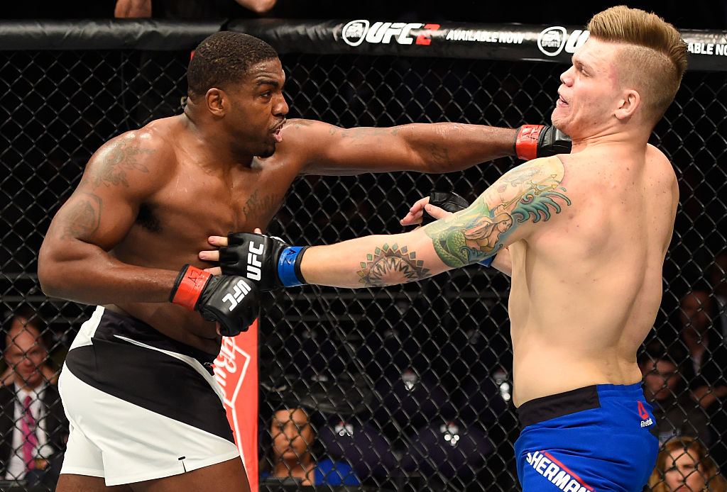 PHOENIX, AZ – JAN. 15: (L-R) Walt Harris punches Chase Sherman in their heavyweight bout during the UFC Fight Night event inside Talking Stick Resort Arena. (Photo by Jeff Bottari/Zuffa LLC)
