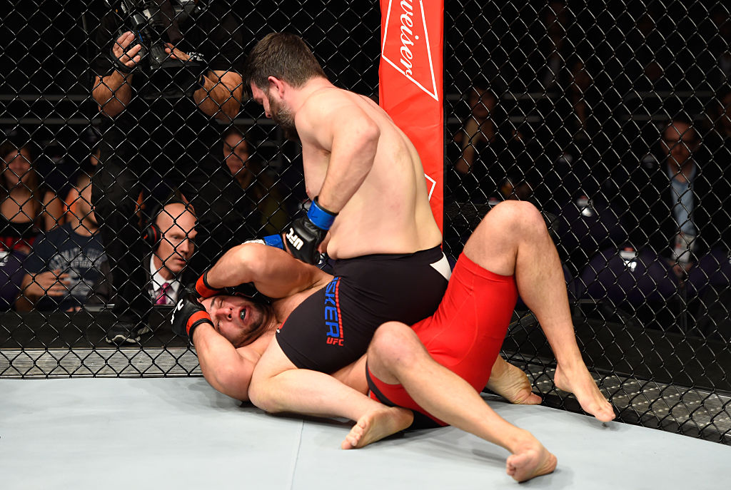 PHOENIX, AZ – JAN. 15: Cyril Asker of France (top) punches Dmitrii Smoliakov of Russia in their heavyweight bout during the UFC Fight Night event inside Talking Stick Resort Arena. (Photo by Jeff Bottari/Zuffa LLC)