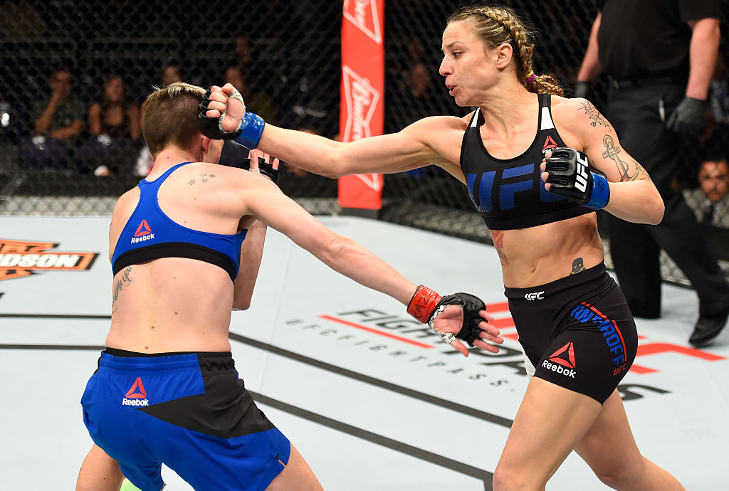 PHOENIX, AZ – JAN. 15: (R-L) Nina Ansaroff punches Jocelyn Jones-Lybarger in their women's strawweight bout during the UFC Fight Night event inside Talking Stick Resort Arena. (Photo by Jeff Bottari/Zuffa LLC)