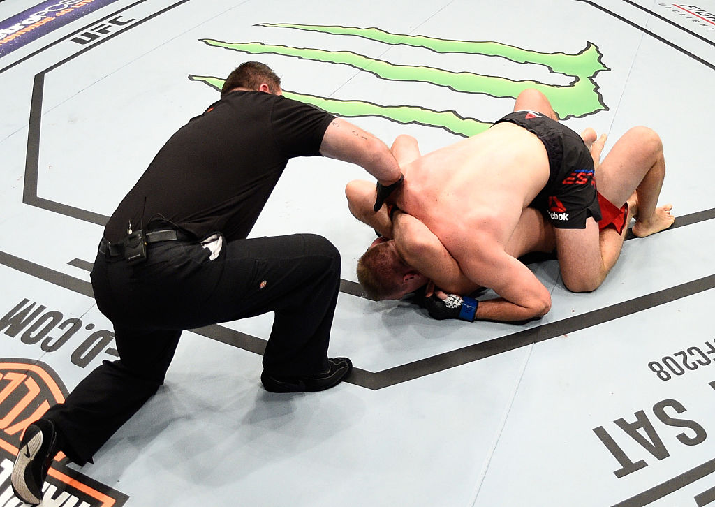 PHOENIX, AZ - JAN. 15: (L-R) Aleksei Oleinik of Russia submits Viktor Pesta of Czech Republic in their heavyweight bout during the UFC Fight Night event inside Talking Stick Resort Arena. (Photo by Jeff Bottari/Zuffa LLC)